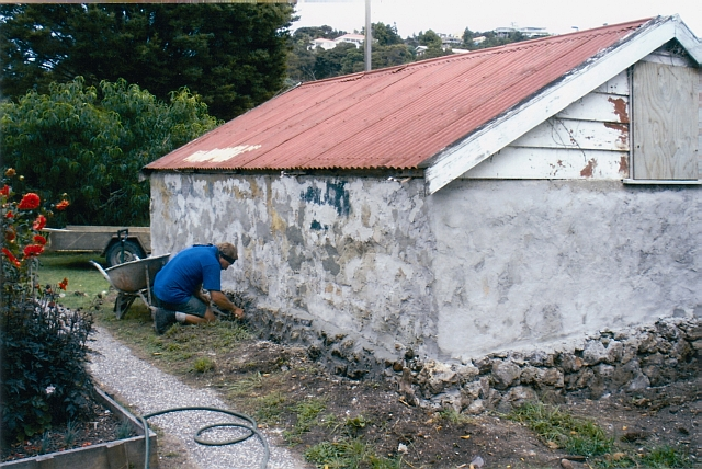 Williams House Paihia - a view from the east side of the stone shed in 2005 showing stonework restoration