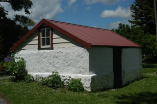 Williams House Paihia - a view of the north side of the stone shed following restoration